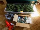 Christmas Tree and decor, extension cords, and hedge trimmer